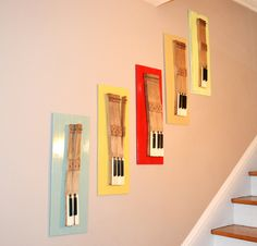 @Debra Collins Old piano keys as hanging art - now you have something to do with the extra piano you were offered