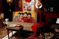 Super cool Beatles couch in an awesome rock n roll music room filled with paraphernalia.