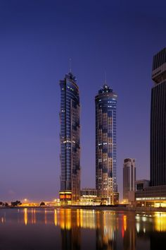 The JW Marriott Marquis Hotel Dubai, dubbed the world's tallest hotel by Guinness World Records, made its grand debut Tuesday. The twin-tower, hotel rises feet. Dubai Hotel, Dubai City, Dubai Skyscraper, Dubai Uae, Dubai Trip, Marriott Hotels, Hotels And Resorts, Best Hotels, Amazing Hotels