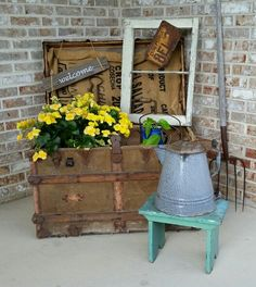 On my front porch - All kinds of estate sale finds here. I made the welcome sign from an old pallet board.