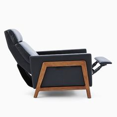 Sit back and stay awhile. Built on a solid ash wood base in a mid-century silhouette, the Spencer Wood-Framed Recliner is upholstered in your choice of leather that only gets softer over time. Recliner With Ottoman, Modern Recliner, Leather Recliner, Saddle Leather, Oversized Furniture, Framed Tv, Living Room Tv, Sit Back, Mid Century Design