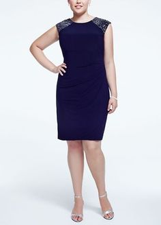 You will look and feel fantastic in this stunning cap sleeve jersey dress!  Cap sleeve bodice features dazzling glass beaded shoulders.  Jersey dress is flattering and comfortable to wear all night long.  Fully lined. Back zip. Imported poly/spandex blend. Professional spot clean. Available in Missy sizes as Style XS6109.