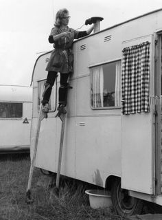 Stilt walker Joy Sloan cleans the chimney of a trailer belonging to a member of British showman Billy Smart's circus in Old Bar, Our Town, Small Farm, Good Ole, Red And White Stripes, One Team, Walk On, Recreational Vehicles, Belgium
