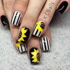 18 Spring Nails - Vibrant yellow sunflower spring nails.
