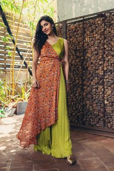 Pear green pleated jumpsuit coordinated with a dainty floral asymmetric shrug completes the look. This attire is perfect for a casual daylight Fabric:Crepe Care: dry clean only Please contact us for any customization Indian Gowns, Indian Wear, Indian Attire, Indian Wedding Outfits, Indian Outfits, Indian Designer Outfits, Designer Dresses, Dress Indian Style, Party Wear Dresses