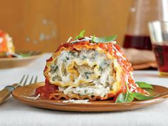 Tomato-Basil Lasagna Rolls | Canned artichokes give the rich filling its meaty heft. Feel free to sub sautéed 'shrooms or spinach.
