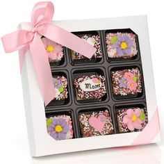Mother's Day Chocolate Dipped Mini Crispy Rice Bars- Window Gift Box of 9  Price:  US$29.99  These delicious Crispy Rice Bites are hand dipped in your choice of decadently delicious fine Belgian Chocolates--Dark, Milk or White--and decorated with adorable hand-crafted Royal Icing Decorations for Mother's Day- Flowers, Hearts, Mother's Day Plaques and Butterflies*- and yummy candy sprinkles.