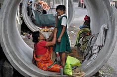 Yes they live in a drain pipe mother gets daugther ready for school. Her hopes and heart go with her child.
