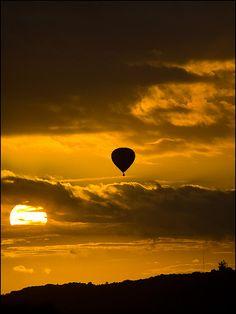 ver un atardecer desde  un globo...