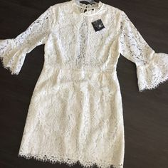 Topshop lace detail dress in white The lace detail on this dress is gorgeous! Unfortunately it's too short on me or I'd love to keep it! The open back is so cute too! Tags on, never worn! Topshop Dresses Long Sleeve