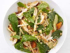 Kale-Sesame Chicken Salad from FoodNetwork.com (with soy sauce, maple syrup, red pepper flakes, sweet potatoes, apple, English cucumber, sesame seeds & oil, peanuts)   maybe use a different nut?