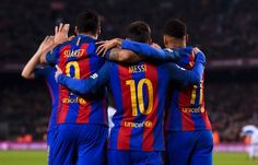 Barcelona's Uruguayan forward Luis Suarez (L) celebrates a goal with teammates Argentinian forward Lionel Messi (C) and Brazilian forward Neymar during the Spanish league football match FC Barcelona vs RCD Espanyol at the Camp Nou stadium in Barcelona on December 18, 2016. / AFP / JOSEP LAGO