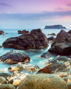 Jeju boasts fresh seafood (gathered by mermaids), hikes, caves and crystal clear beaches. Basalt Rock, Jeju Island, Three Sisters, Fresh Seafood, Holiday Pictures, South Korea, Traveling By Yourself, Mermaids, Beaches