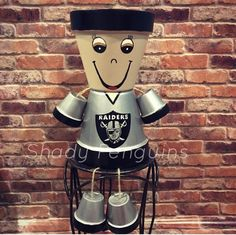 flower pots outdoor Custom Made Hand Painted Oakland Raiders Flower Pot Statue. The flower pot statue is made with pots making the statue approximately tall. The flower po Flower Pot Art, Flower Pot Crafts, Flower Pots, Diy Flower, Tree Crafts, Kids Crafts, Flower Pot People, Clay Pot People, Clay Pot Projects