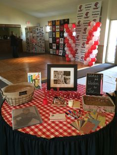 Guest sign in table featured a framed pic of the graduate, a chalk board sign inviting guests to write words of wisdom on pieces of scrapbook paper. A burlap and wrought iron basket held cards.
