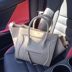 What's in your passenger seat?? We're drooling over this Celine Beige Leather Small Square Phantom Luggage Tote! Available to purchase on www.mymoshposh.com! #Celine #celinephantom #fashion #trendy #luxury #ourfavoritebag #obsessed #purselover #purseblog #whatsinyourpassengerseat #shoppingbuddy #mymoshposh #moshposhfinds #designerconsignment