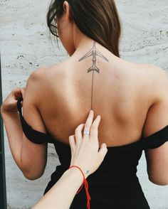 airplane back tattoo