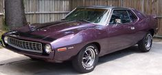 1972 AMC Javelin. This was my first car. (Not this photo but this car). Mine was bronze and sooo cute. Had fat tires and was jacked up a bit. :)