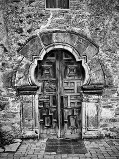 Black and white architectural photograph of the carved wooden front doors of the old Spanish Mission Espada, built in the in San Antonio, Texas. Portal, Last Door, Wooden Front Doors, Old Churches, Pretty Images, Texas Hill Country, Black And White Pictures, Black And White Photography, San Antonio