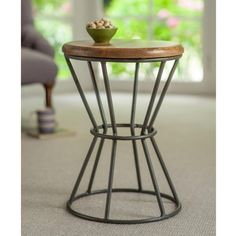 This practical side table is perfect for next to the sofa or as a lamp stand. Both stylish and practical with a solid, waxed mango wood top and metal legs.
