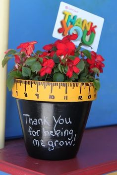 "This is crazy cute.  Take a pot - paint with chalkboard paint (or even just plain old black paint)...  paint the rim yellow...  add the lines / numbers (maybe with a sharpie?) and pop a pretty plant inside.  When doing for the whole class, say ""Thank you for helping us grow""  LOVE!"