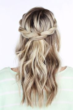 This hairstyle uses the twist technique to depict a braided look. It's fairly simple and suitable for short to long hair length. Refer to the step-by-step instruction to learn how to make a twisted crown braid. Step 1: Take a section of hair near your part. Divide it into two sections Step 2: Add a new section of hair to the front piece. Add a new section of hair to the back piece Step 3: Twist the sections together with the front piece going over the back piece. Once you reach the back o...