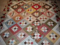 Cute nine patches.  September Simple Abundance by QuiltingLife, via Flickr