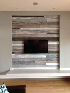 Love this wall....DIY Reclaimed Wood Wall