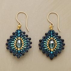"Blue Plume Earrings  Bursts of blue goldstone emanate from golden Miyuki beads and an ""eye"" of green quartz, evoking a peacock's plumage."