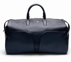 Shop the Bentley Continental Weekender - a luxury leather travel bag based on the iconic wing shape of the Bentley dashboard, Order from the official Bentley Collection website today. Bentley Motors, Bentley Continental, Travel Bags, Calf Leather, Metal Working, Contemporary Design, Calves, Dust Bag, Shoulder Strap
