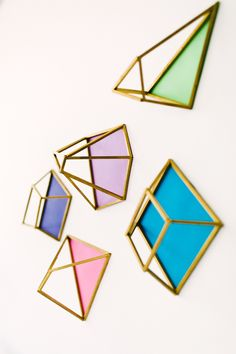 DIY geometric wall shapes - photo by Emily Chidester DIY by Studio Cultivate for Ruffled http://ruffledblog.com/diy-geometric-wall-decor