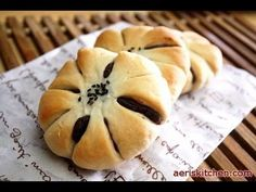 Sweet Red Bean Paste Bread (단팥빵) - 3.5 Cups AP Flour; 2.5 Cups Red Bean Paste; 2/3 Cup Lukewarm Water; 2/3 Lukewarm Milk; 1/4 Cup Sugar; 1/4 Cup Melted Butter; 2tsp Active Dry Yeast; 1.5 tsp salt; Melted Butter for Brushing; Black Sesame Seeds 350F 20m
