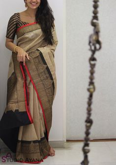 Product Details: Saree: Banaras tussar silk in ivory with black borders and burnt orange selvedge.Blouse: Black silk with coordinated borders Note: Colours may vary from screen to screen. Cotton Saree Designs, Half Saree Designs, Saree Blouse Neck Designs, Fancy Blouse Designs, Sari Blouse, Blouse Patterns, Trendy Sarees, Stylish Sarees, Fancy Sarees