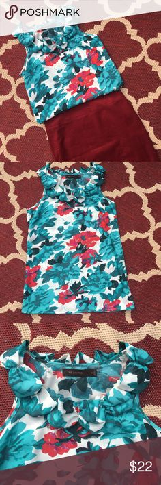 The Limited Vibrant Floral Top The Limited gorgeous turquoise and red floral top. Looks stunning paired with a red pencil skirt (see skirt listing in my closet). Ruffle and bow detail along neckline. Also would look adorable with shorts or jeans. This top will take you from work to weekend! The Limited Tops Blouses
