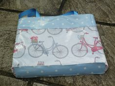 Summer Bike Ride oilcloth holiday tote, fully lined, with contrast spot base and top. From www.etsy.com/shop/dagenaisdesign