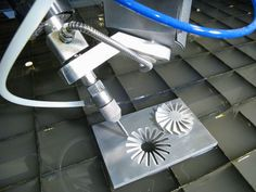 The CNC water jet cutting system in St Louis provided by St Louis WaterJet is a practical alternate to conventional tooling that completely eliminates heat affected zones, recast layers, work hardening and thermal stress. Sheet Metal Fabrication, Digital Fabrication, Machine Tools, Cnc Machine, 5 Axis Cnc, Work Hardening, 3d Cnc, Plasma, Cnc Projects