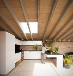 In the southwest of the house, a courtyard allows a flood of sunlight in the kitchen, study and bathroom areas; this design also provides a natural, environmentally friendly heat source, as the solar greenhouse air in turn warms the home.