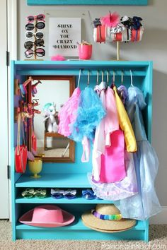 Transform an IKEA BILLY Bookcase into a bright blue wardrobe for dress-up clothes.