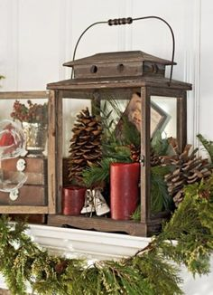 An old fashioned wooden lantern with pine cones, greenery, candles, and whatever fits the mood!