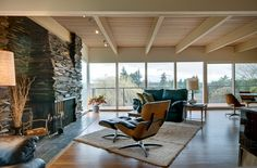 beautiful...exposed beams, stone fireplace, hardwood floors, and large windows