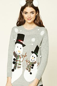 083e0344a2a A knit holiday sweater featuring snowman graphics with sequined scarves and  snowflake appliques