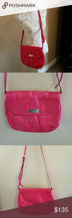 Marc by Marc Jacobs Cross Body Bag 🎉HPx2🎉 🎉HPx2🎉NWOT Berry Colored Marc by Marc Jacobs Cross Body Bag w/ Adjustable Strap. I would describe the color as Raspberry Sorbet, truest color in the 2nd pic. The flap has a magnetic snap closure. Inside there is a small zippered pocket & two additional open pockets. This bag has never been used. It is a RePosh. The original owner described it as NWOT. The 4th pic is showing some dark marks on the top of the bag that are hard to see but are there…