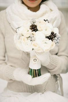 I love this bouquet filled with pinecones and accented with fabric details on the handle.Related: 25 Gorgeous Bouquets for Winter Weddings