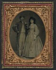 Unidentified soldier in Union sergeant's frock coat and forage cap with unidentified woman in dress and hat with veil  Date Created/Publishe...
