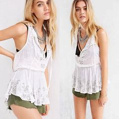 """Écote UO Filigree Mirror Embellished Cami Beautifully boho soft woven cotton tank top with embroidered mirror and faceted, set bead embellishment by Ecote, only at UO. Complete with a deep, crochet-trimmed v-neck, a gathered tie and elastic at the waist with a ruffled hem in a lightweight, semi-sheer design.  CONTENT + CARE - Cotton - Hand wash - Imported  SIZE + FIT - Model is 5'9"""" and wearing size Small - Measurements taken from size Medium - Chest: 37"""" - Length: 26.75""""No trades. Please…"""