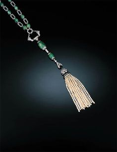 A Rare Art Deco Diamond, Emerald, Pearl and Onyx Sautoir by Chaumet  The necklace composed of shaped rectangular rose-cut diamond links alternating with cabochon emerald collets, the front suspending openwork diamond and onyx link with two graduated emerald beads capped by rose-cut diamonds, the pearl tassel with diamond and onyx mitre-shaped mount below bud-shaped link, circa 1925, with lozenge maker's mark, necklace 52cm. long, detaching to form two bracelets. Chaumet