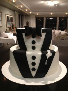 Tuxedo themed cake... Getting this for my husband's 30th birthday!