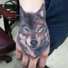 Hand tattoo Wolf tattoo @francisco_javier_evil on Instagram