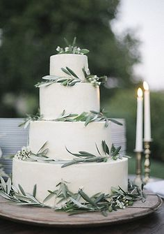 This wedding cake is so elegant and romantic, and the olive branches add an organic feel to it.
