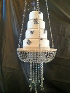 31 Cool and Classic Wedding Cake Stands Chandelier Cake Stand, Hanging Chandelier, Chandelier Wedding, Wedding Cake Stands, Elegant Wedding Cakes, Luxury Wedding Cake, Chandeliers, Crystal Wedding, Tiered Cakes